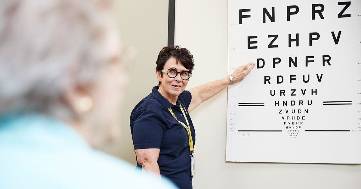 Vision Australia clinician points to an eye chart