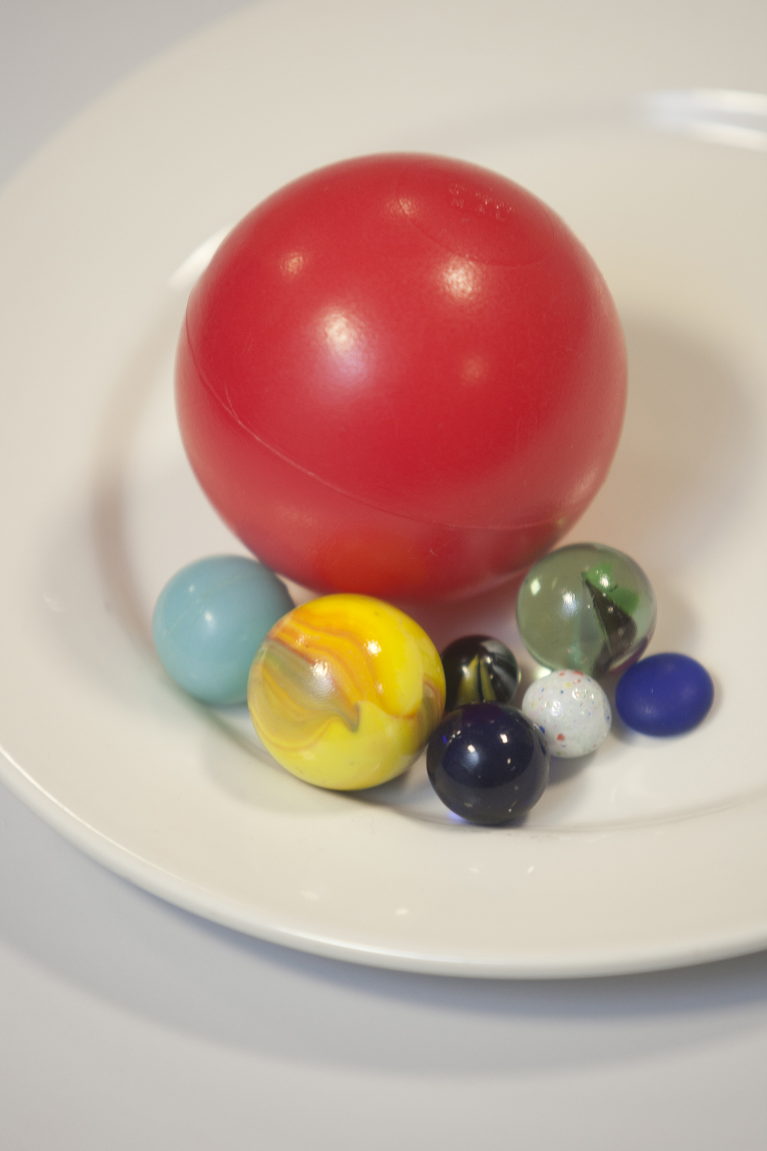 Different coloured and sized balls used for vision tests