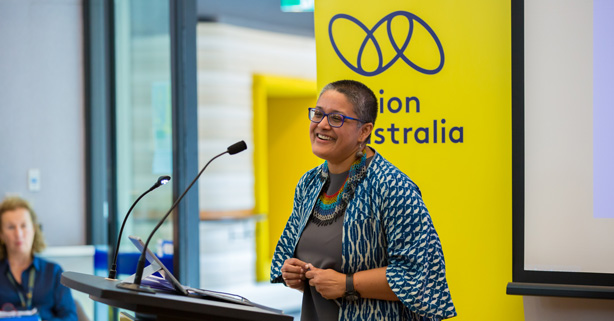 Navanita speaking at a Vision Australia event